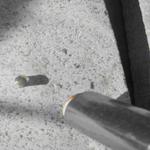 closeup of hand torch heating solder