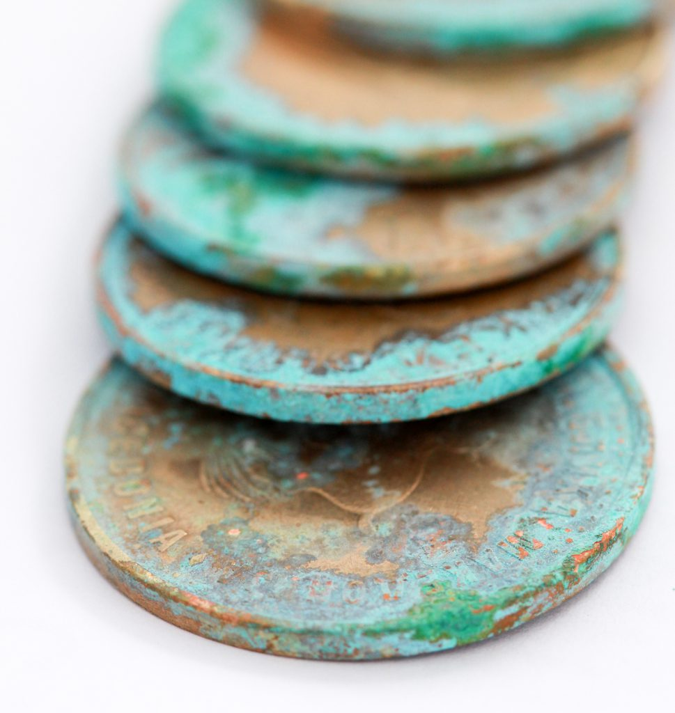 copper coins that have undergone the patina process