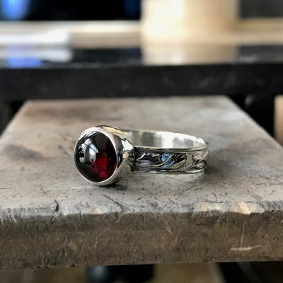 bezel setting with cabochon gemstone