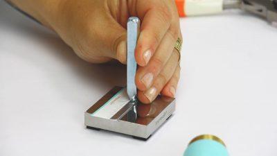holding design stamp flush