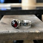 cabochon ring on table