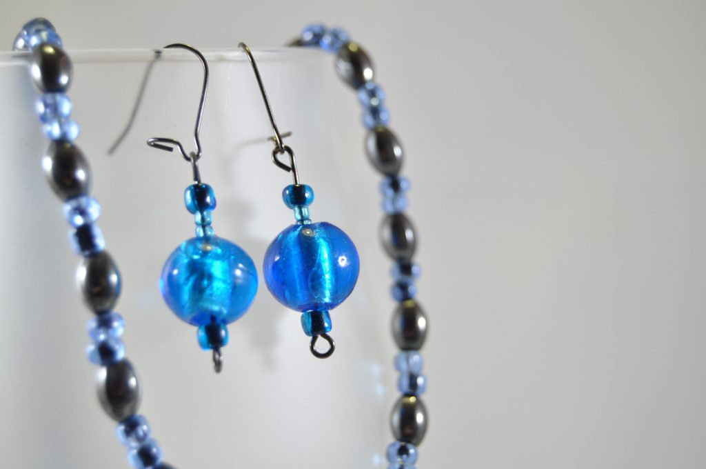 819841615 blue beaded drop earring with hook wire attachment and beaded necklace  backdrop