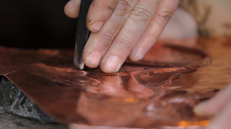 Using the chasing and repoussé technique