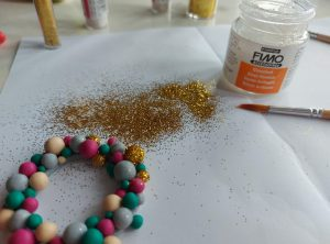 Adding glitter to the baubles