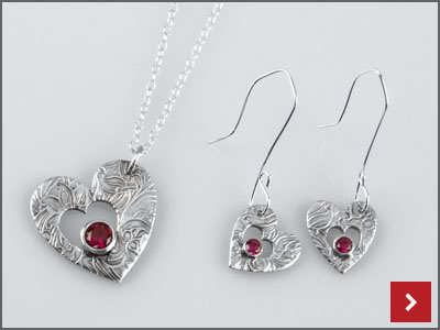 Art Clay Silver Heart Set With Stones